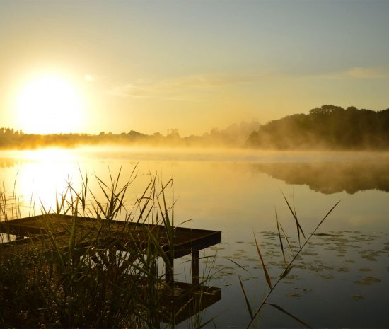 Mist over the Water Frosty morning sunrise with mist still lying on the water in one of Co. Fermanagh's many fishing spots.
